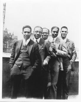 Langston Hughes with others overlooking St. Nicholas Avenue.
